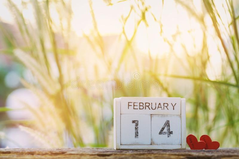 Wooden calendar show of February 14 with pink heart. Valentine`s Day, or St Valentine`s Day. Wooden calendar show of February 14 with pink heart. Valentine`s stock photos