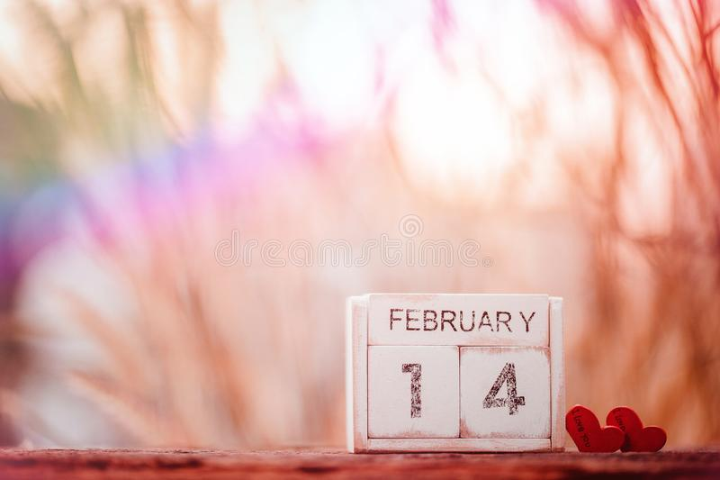 Wooden calendar show of February 14. Valentine`s Day, or St Valentine`s Day, is celebrated every year on 14 February stock photos