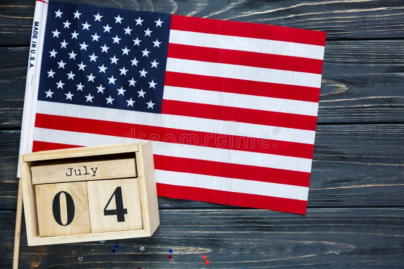 Wooden calendar 4th of July day of American independence, decorations,  flag, candles, straws. USA holiday decorations stock images