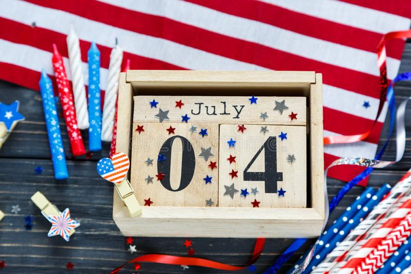Wooden calendar 4th of July day of American independence, decorations,  flag, candles, straws. USA holiday decorations stock photo