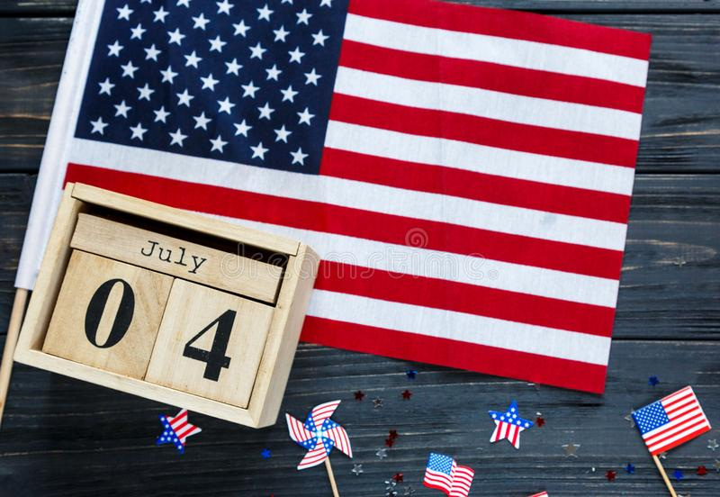 Wooden calendar 4th of July day of American independence, decorations,  flag, candles, straws. USA holiday decorations royalty free stock images