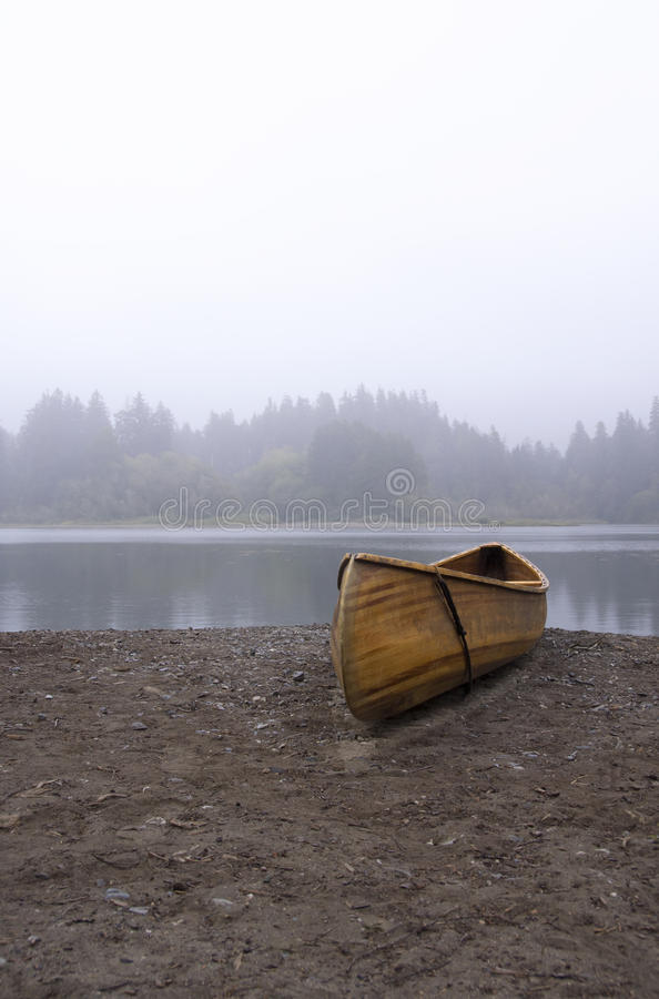A wooden canoe on a beach royalty free stock photography