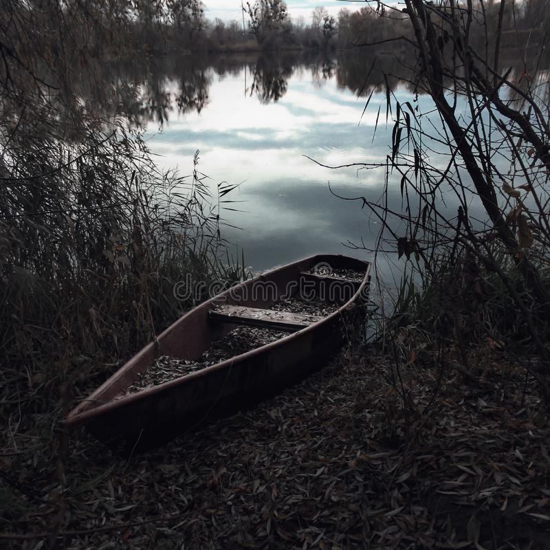 Wooden canoe on river banks royalty free stock photos
