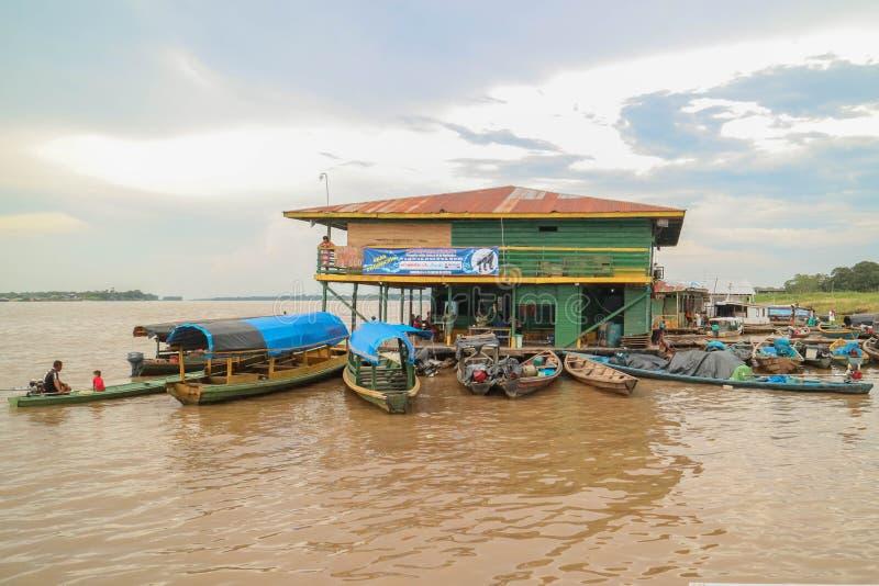 Wooden canoe in river port stock photos