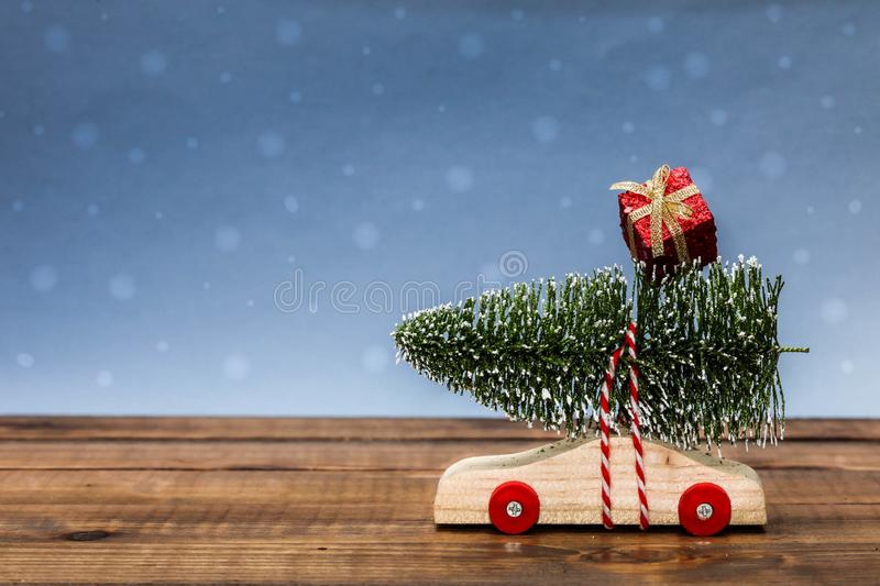 Wooden car with christmas tree and gift box royalty free stock photo