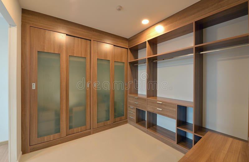 wooden carbinets in dressing room in modern home, interior design royalty free stock photo