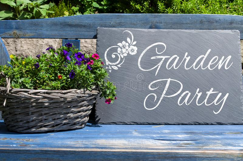 Wooden cardboard and chalkboard with garden party. With plants stock images