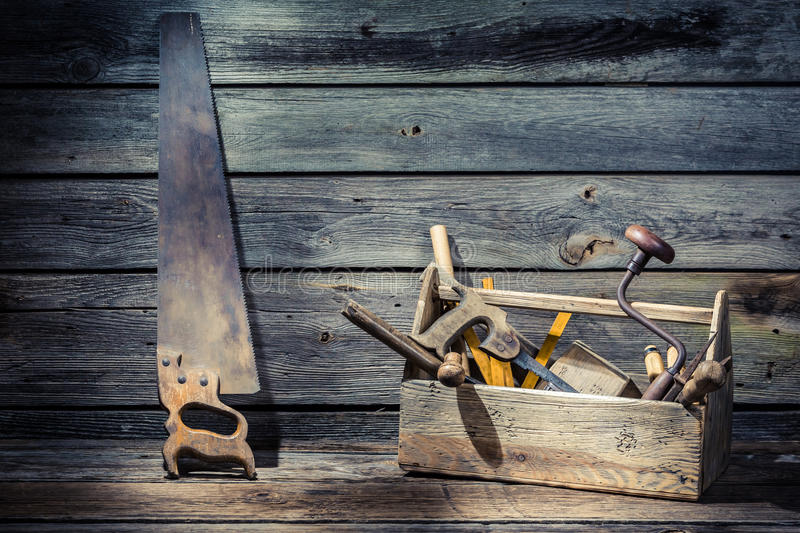 Wooden carpenters tool box. On old wooden table stock photo