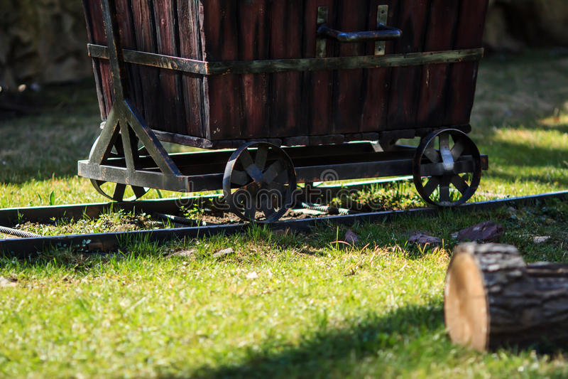 Wooden cart on rails stock photography