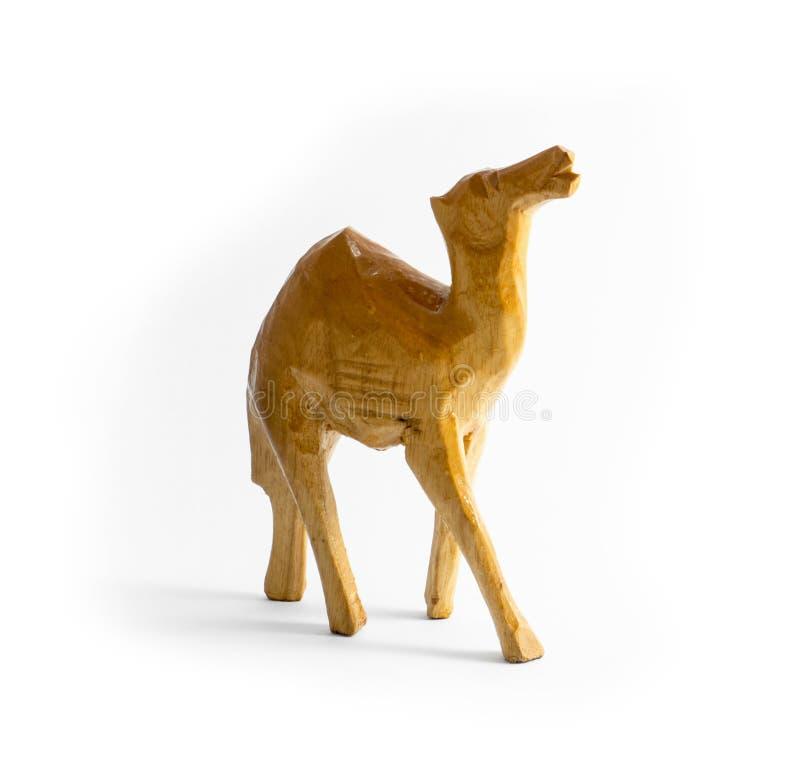 Wooden carved camel stock image