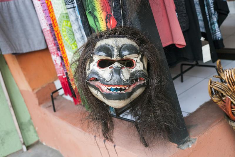 Wooden carved mask of evil monkey stock photography