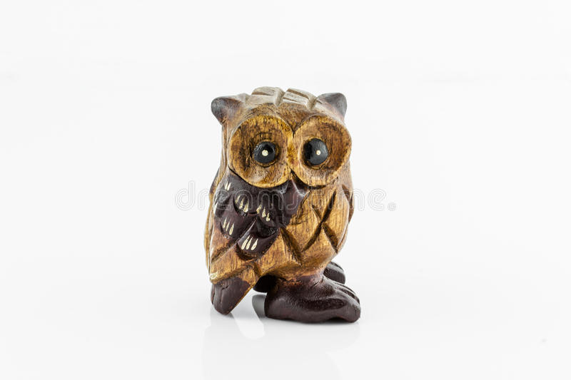 Wooden carved Owl. On white background stock photo