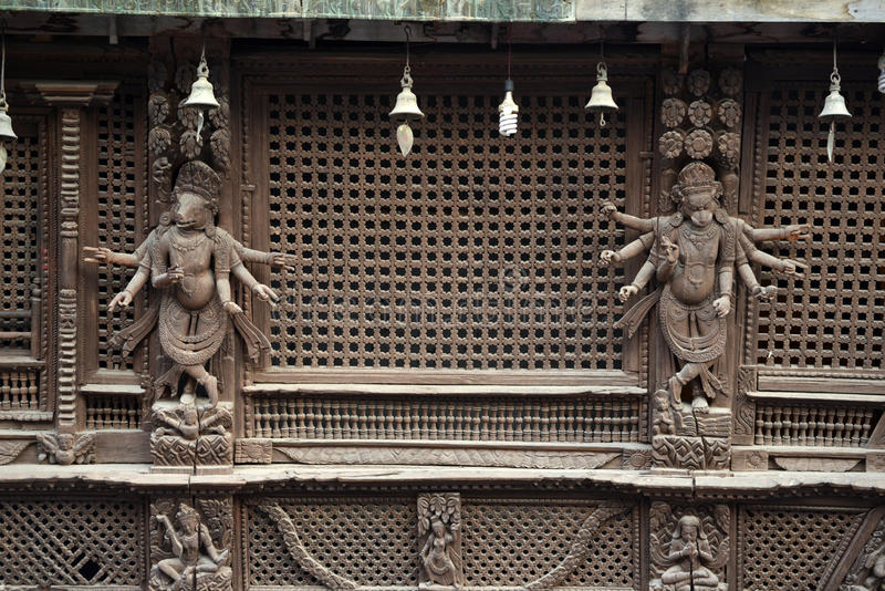 Wooden carvings on a Hindu temple in Kathmandu, Nepal. Now destroyed by the powerful earthquake that hit Nepal royalty free stock image
