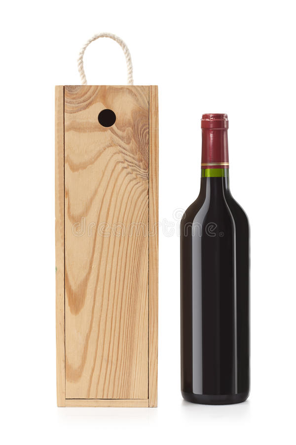 Wooden case with wine bottle royalty free stock photo