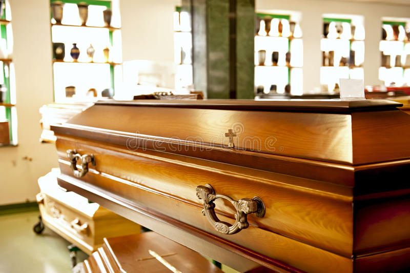 Wooden casket. Close up of the wooden casket displayed in a casket store stock images