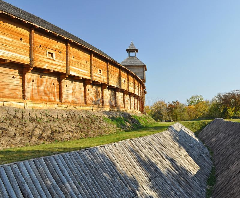 An old wooden fortress with high walls and a water ditch stock images