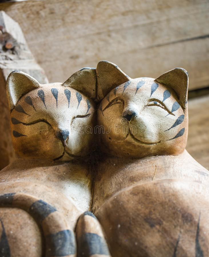 Wooden Cat Dolls on old table. The Wooden Cat Dolls on old table stock photo