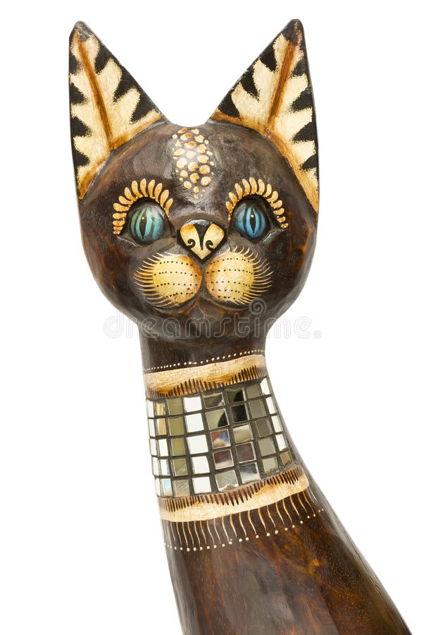 Wooden cat head isolated. Wooden cat head with blue eyes sculprure isolated art object stock photos