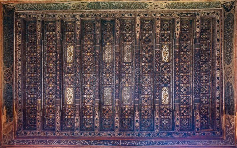 Wooden ceiling decorated with floral pattern decorations at ottoman historic Beit El Set Waseela building، Old Cairo, Egypt stock photo