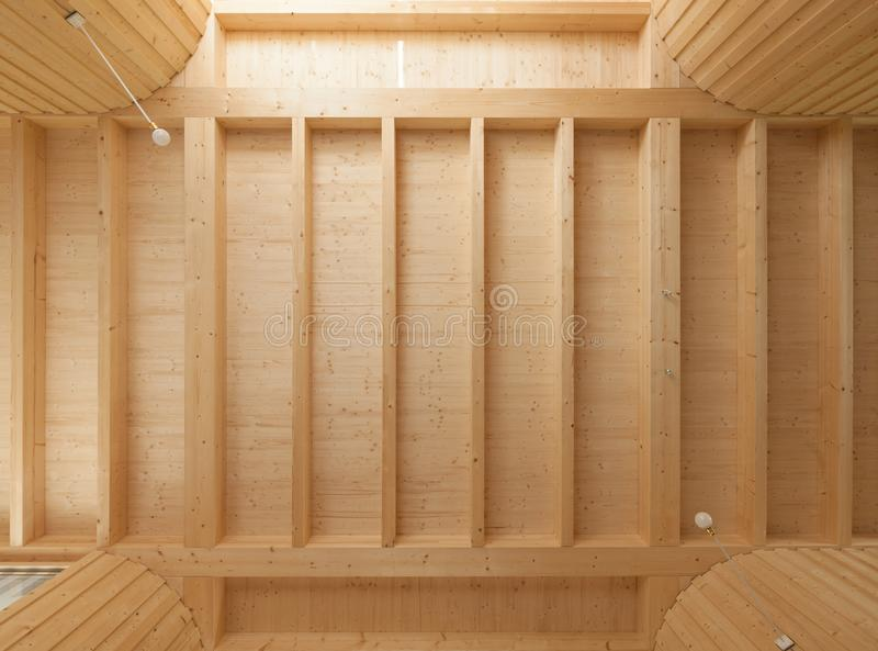 Wooden ceiling with exposed beams stock photo