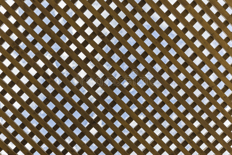 Wooden ceiling in the gazebo in the form of cells stock photography