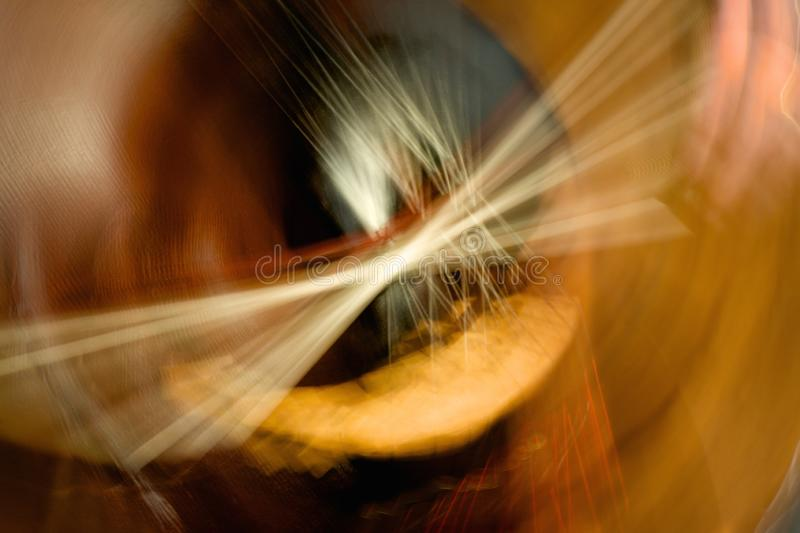 Abstract cello being played. Wooden cello being played with bow abstrack royalty free stock images