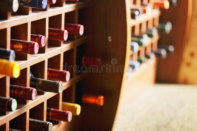 Wooden cells with wine bottles
