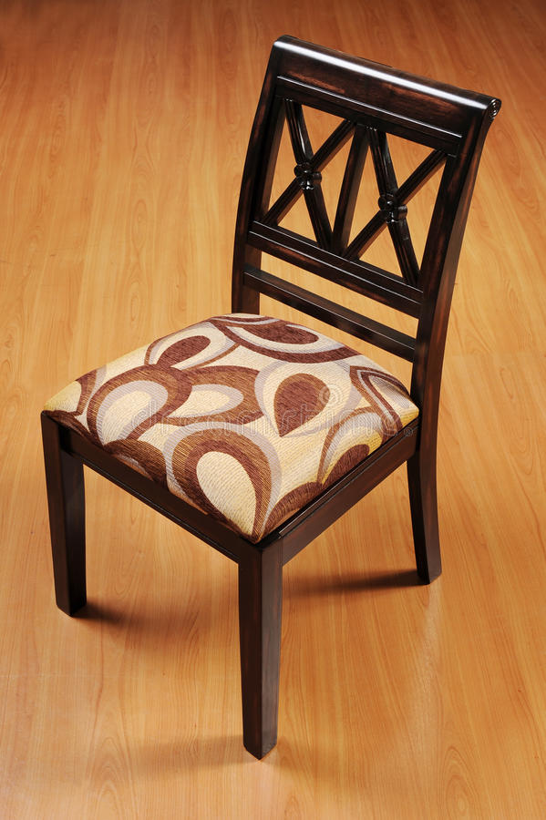 Wooden Chair. Isolated wooden chair with cushion royalty free stock photos