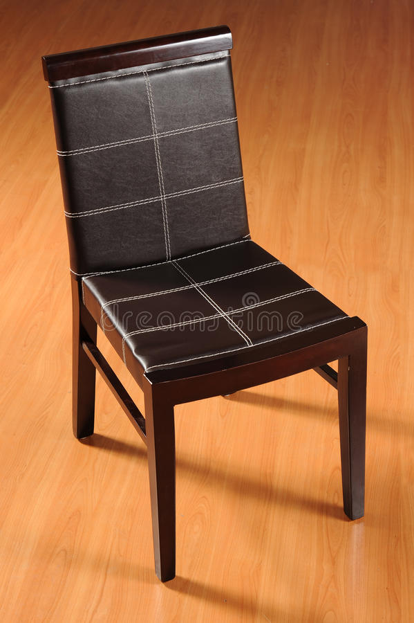 Wooden Chair. Isolated black colour wooden chair in studio royalty free stock photography