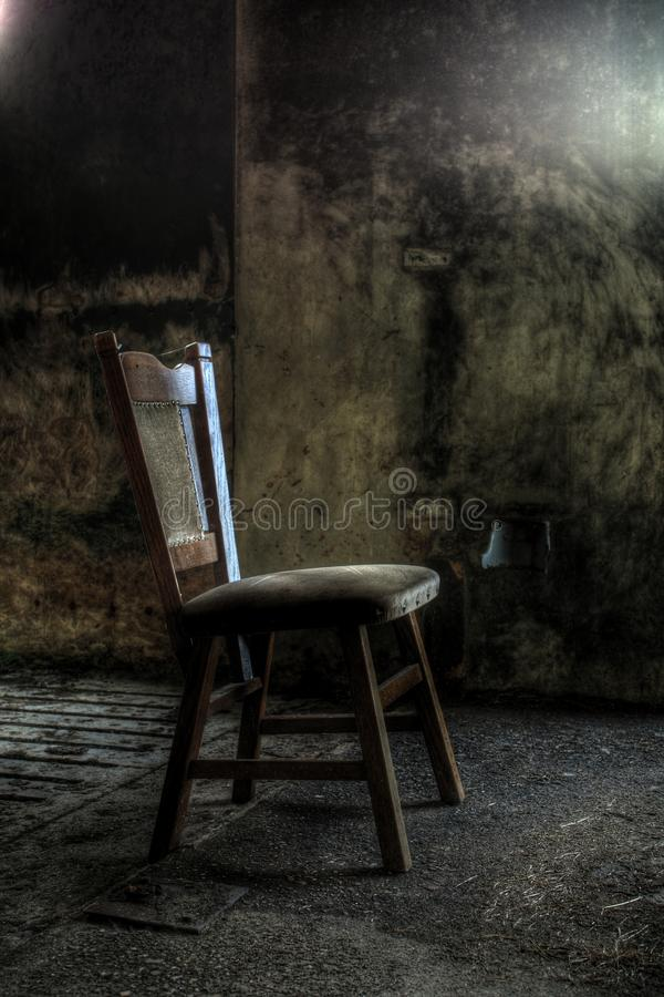 Wooden chair in derelict house royalty free stock photo