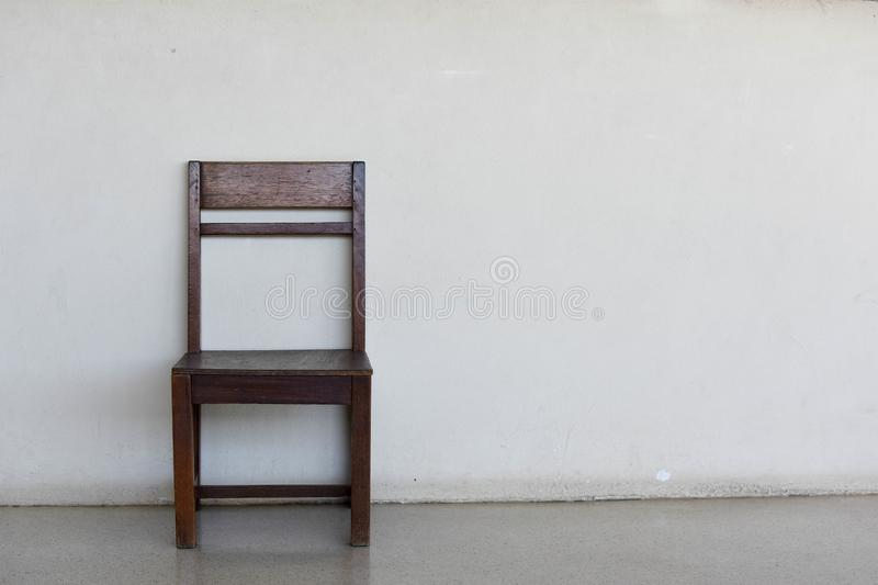 Wooden chair on the wall background royalty free stock photos