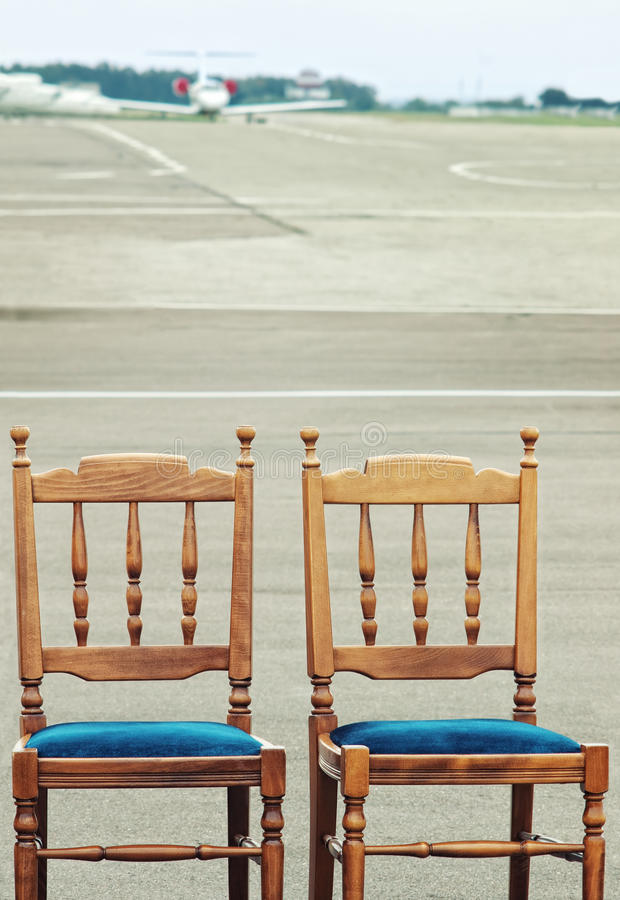 Wooden Chairs On Airfield Stock Photo