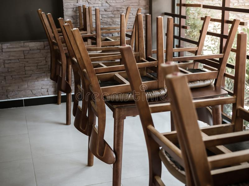 Restaurant Closed. Wooden Chairs areUpside Down On Wooden Table in Restaurant for Cleaning Floor royalty free stock images