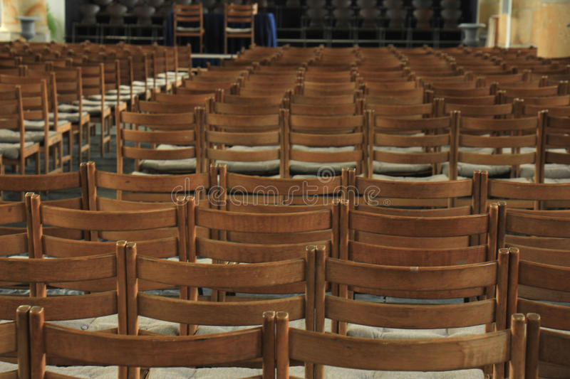 Wooden chairs in a church. Simple wooden chairs in a Dutch Reformed Church royalty free stock photography