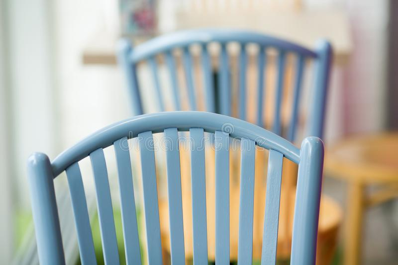 Wooden chairs close-up in a cafe. Wooden chairs close-up in a street cafe stock photos
