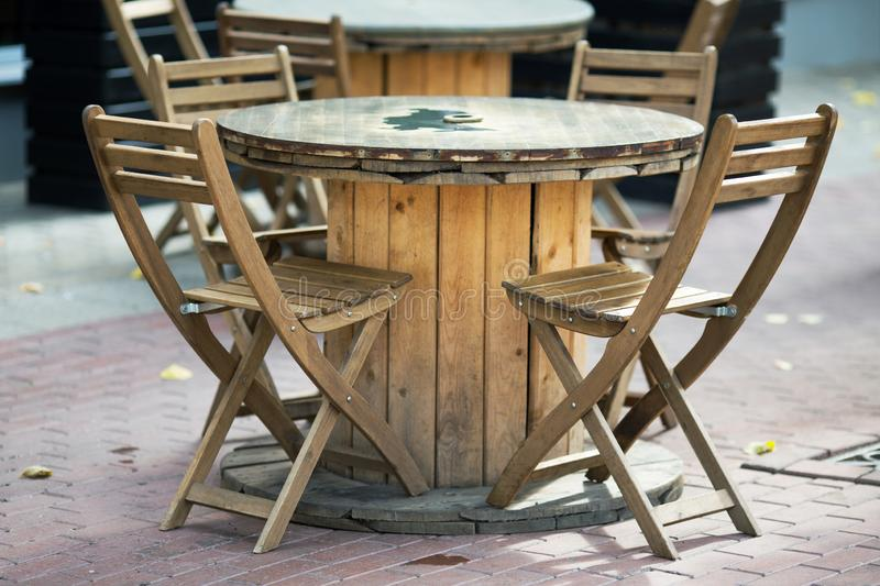 Wooden chairs close-up in a cafe. Wooden chairs close-up in a street cafe royalty free stock photo