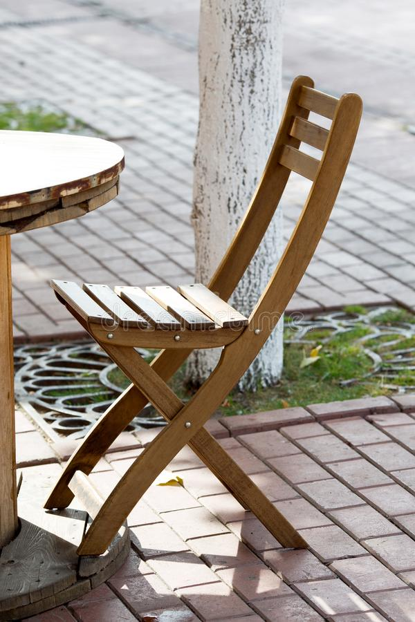 Wooden chairs close-up in a street. Cafe stock images