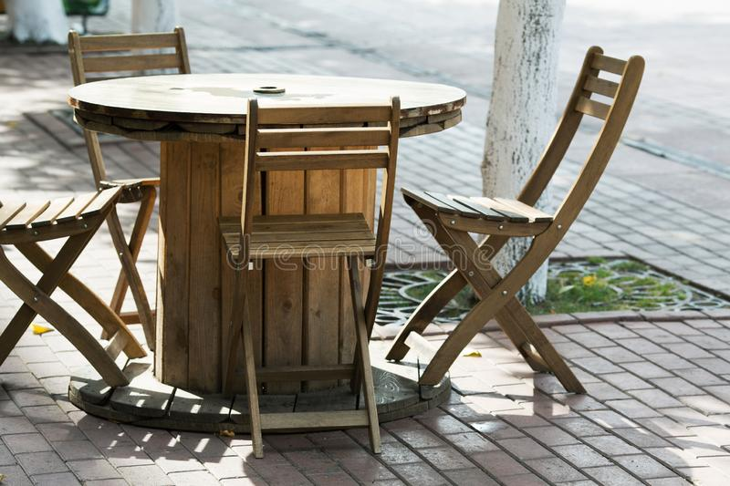 Wooden chairs in a street cafe. Wooden chairs close-up in a street cafe royalty free stock image
