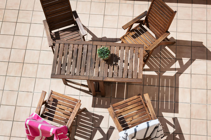 Wooden chairs and a table stock images