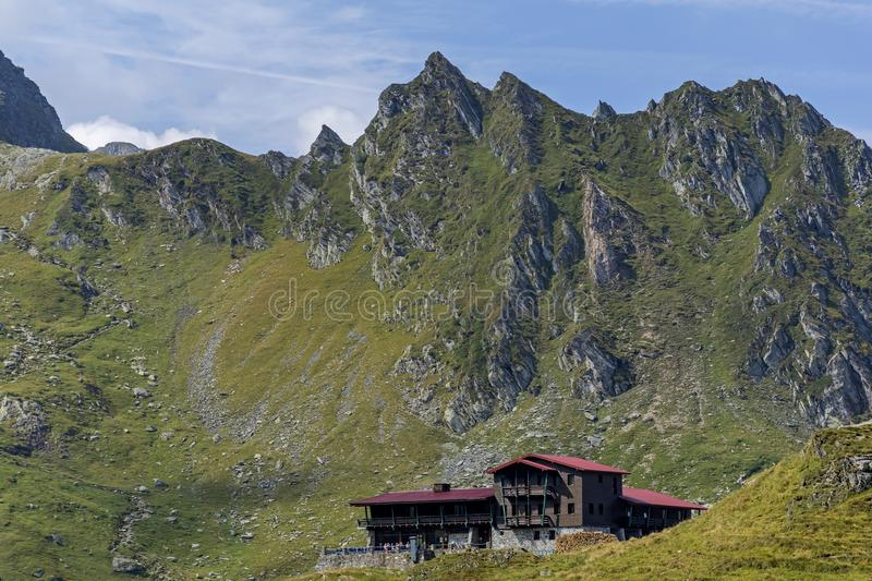 Wooden chalet under the summit . Balea lac mountain lake resort in Carpathians mountains royalty free stock images