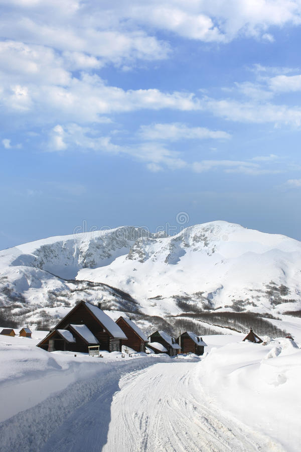 Wooden chalets. On snowy mountain stock photos