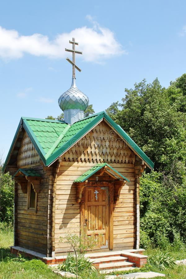 Small wooden Orthodox chapel at holy spring in Russian outback on sunny summer day. Concept — Christianity, Orthodoxy, Faith, royalty free stock photography