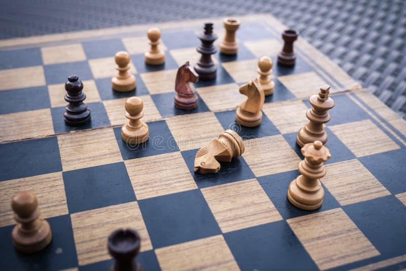 Wooden Chess board Business strategy idea concept background. Vi. Ntage dark corner style stock photo