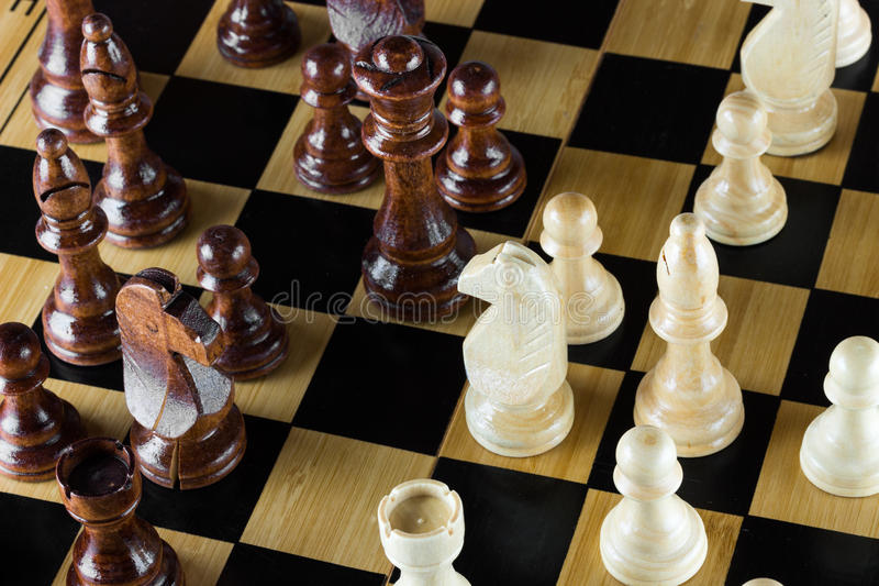 Wooden chess on chess board royalty free stock photo