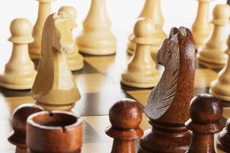 Wooden chess on chess board royalty free stock photography