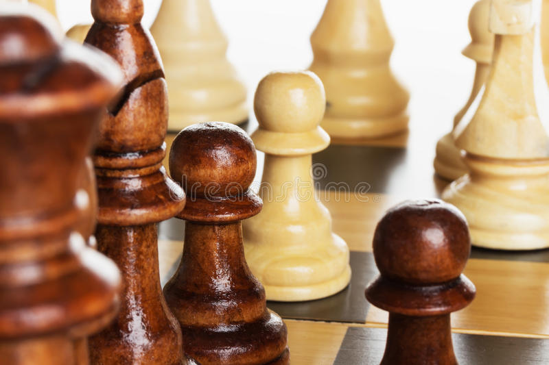 Wooden chess on chess board royalty free stock photos