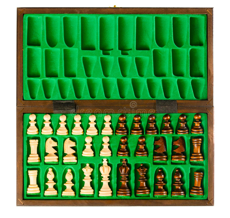 Wooden chess pieces. Set of wooden chess pieces in green box royalty free stock image