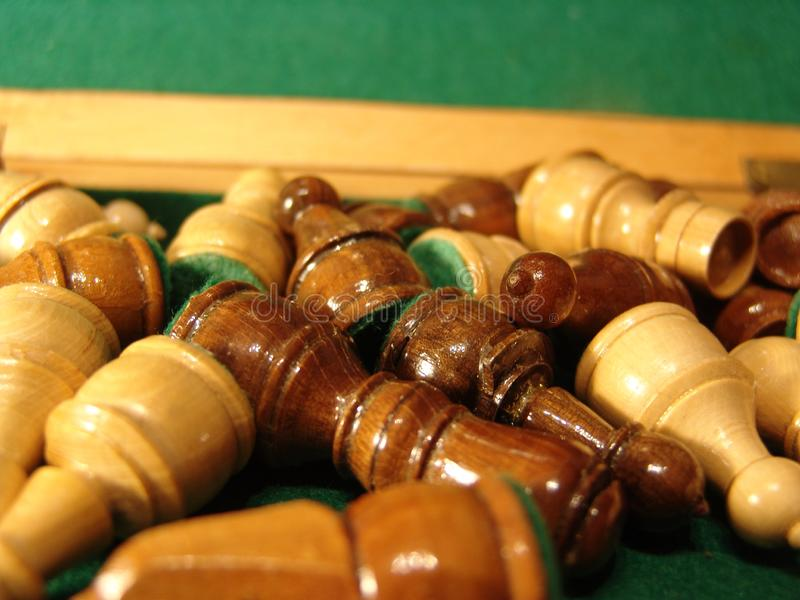 Wooden Chess Pieces on Green Felt. Close Up Macro royalty free stock photo