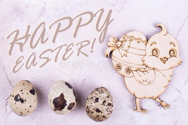 Wooden chicken and eggs, Happy Easter text stock photography