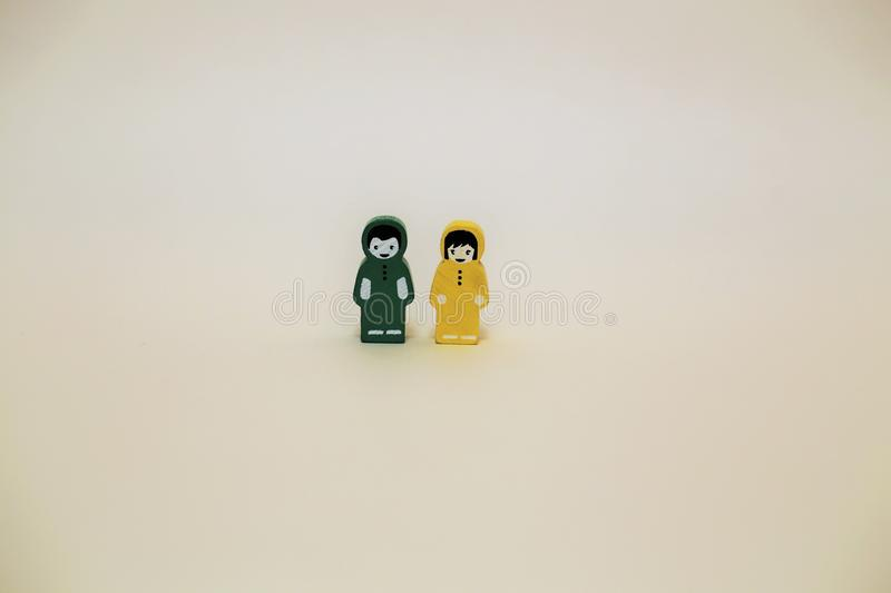 Wooden children figurines over white background royalty free stock images